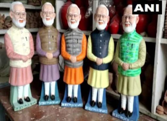 An artist in Bihar is making statues of Prime Minister Modi into money banks